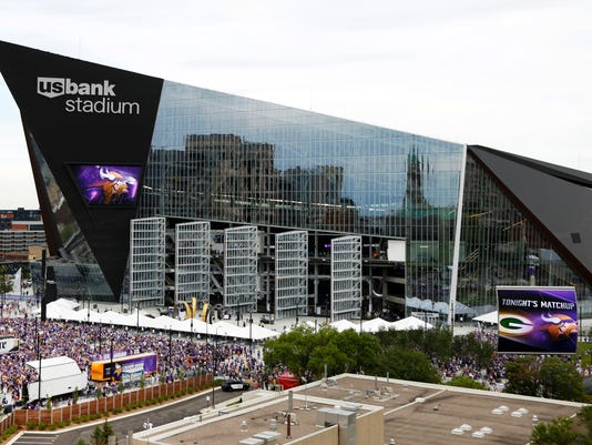 Fans arrive at U.S. Bank Stadium before an NFL football game between the Minnesota Vikings and the Green Bay Packers, Sunday, Sept. 18, 2016, in Minneapolis. (AP Photo/Andy Clayton-King)