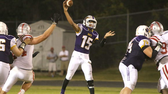 North Henderson's Kalin Ensley (15) throws a pass in Friday's 35-10 home loss to Hendersonville.