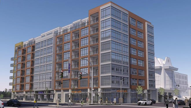 The Metreau Apartments development, shown in this rendering, is scheduled for completion next summer at 115 E. Walnut St. in downtown Green Bay