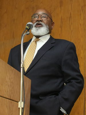 Grambling State president Willie Larkin talks about potential budget cuts facing the school during a town hall meeting last week.