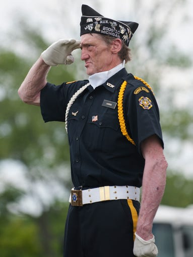 George Harris of VFW Post 3087 of Flint salutes during