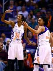 Sep 9, 2014; Phoenix, AZ, USA; Phoenix Mercury guard DeWanna Bonner (24) and forward Candice Dupree (4) react against the Chicago Sky during game two of the WNBA Finals at US Airways Center. Mandatory Credit: Mark J. Rebilas-USA TODAY Sports