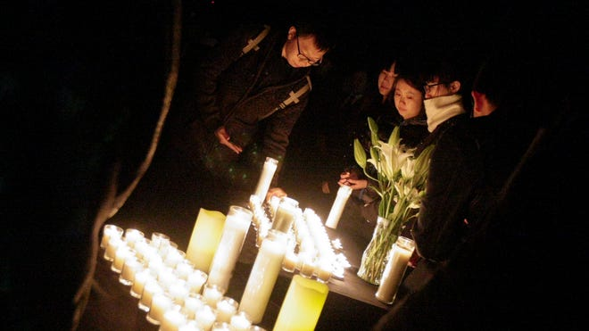 Friends of Iowa State University student Tong Shao attend a memorial service in her honor on the ISU campus Friday in Ames.