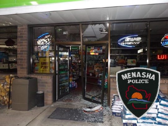 The damage to the entrance doors at JS Foods.