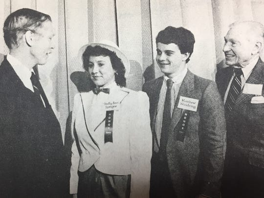 Shelley Ann Sprague, left center, and Matt Woodring, right center, were both honored with special awards in the 4-H Award of Excellence Program in March 1984.