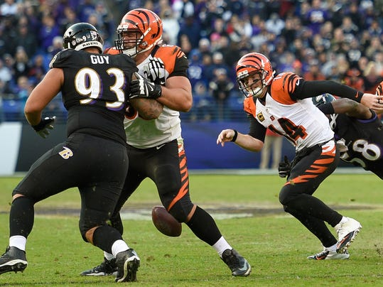 FILE - In this Nov. 27, 2016, file photo, Cincinnati Bengals quarterback Andy Dalton (14) chases a fumbled ball after being sacked by Baltimore Ravens outside linebacker Elvis Dumervil (58), far right, during the second half of an NFL football game against the Baltimore Ravens in Baltimore. Back in action at long last, Elvis Dumervil hopes to put a rousing finish on a frustrating season in which he's missed eight games while recovering from foot surgery. (AP Photo/Nick Wass)