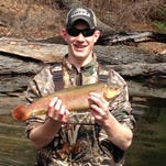 Noah Susick caught this 19-inch rainbow trout on the Huron River on the opening day of trout season.
