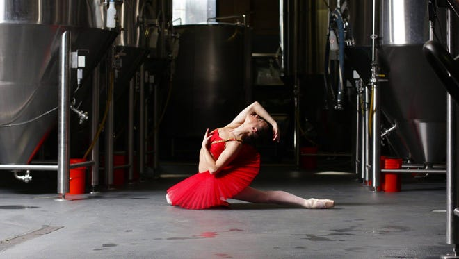 Dancer Casie Wheeler poses for a photo at Sun King Brewing Company.