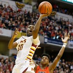Eddy Collins drives past Sean East of New Albany in the Class 4A state championship Saturday, March 26, 2016, at Bankers Life Fieldhouse in Indianapolis. McCutcheon lost to New Albany 62-59.