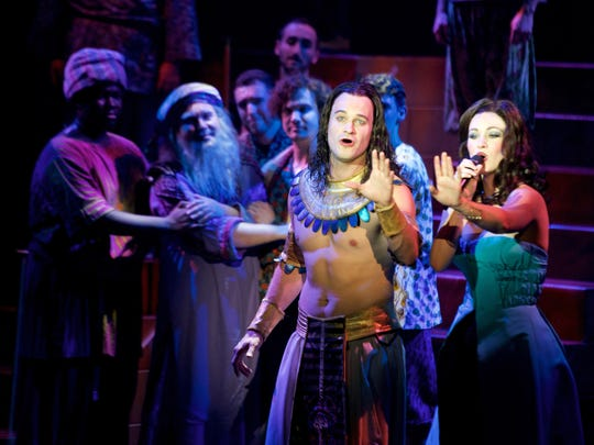 "JC McCann as Joseph and Laura Helm as the narrator perform ""Any Dream Will Do"" with the company of the national tour of ""Joseph and the Amazing Technicolor Dreamcoat."""