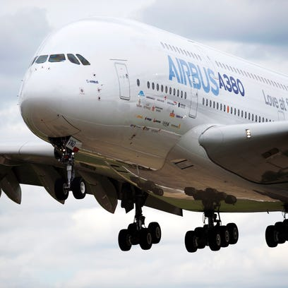 An Airbus A380 flies over Le Bourget airport, north of Paris, on June 17, 2013.
