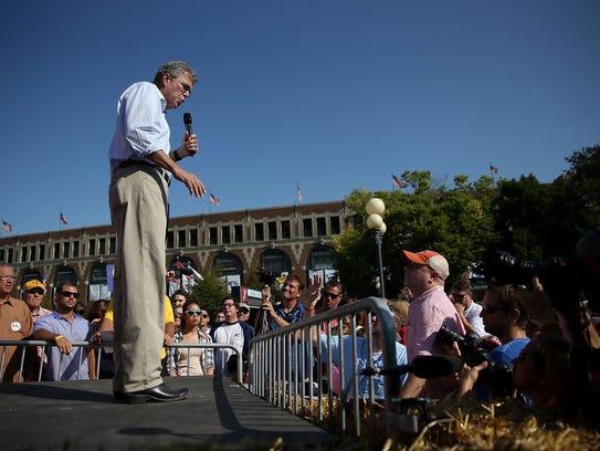 Jeb Bush speaks to fairgoers during the Iowa State