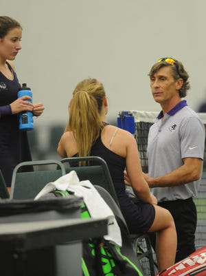 ACU tennis coach John Walker, right, talks to players Lucile Pothier (left) and Sara Adams during a break in their No. 2 doubles match against TCU on Jan. 21, 2017. at the Teague Special Events Center.