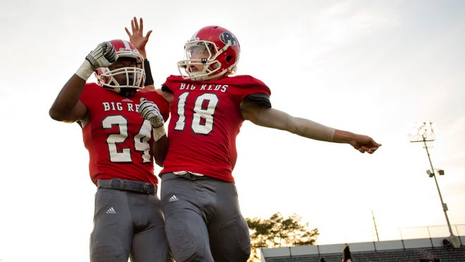 Port Huron junior Osric Anderson and senior Austin O'Hare are introduced during a football game Friday, September 25, 2015 at Memorial Stadium in Port Huron.