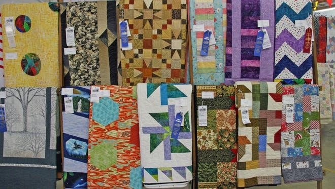 Quilts are on display at one of the exhibit buildings at the 2017 Warren County Fair.