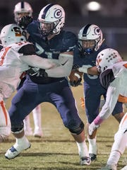 Central Valley Christian's Dirk Nelson, left, blocks
