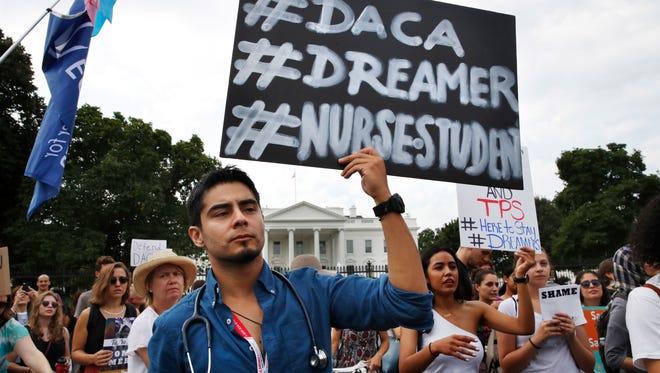 Nursing student Carlos Esteban, a DACA recipient,  rallies outside the White House on Sept. 5, 2017.
