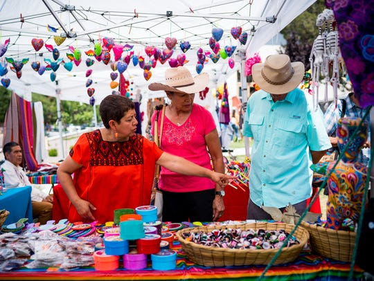 Attendees at last year's ¡Fiesta Latina! browse some