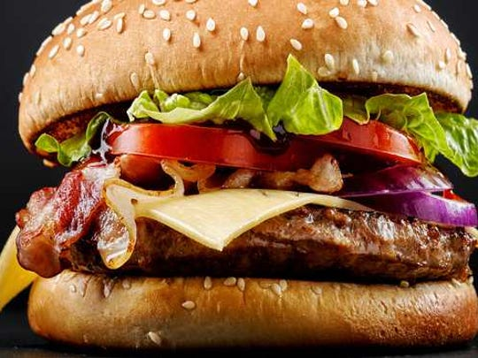 A hamburger on black background.