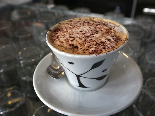 A cup of cappuccino is ready to drink at Lino's Coffee.