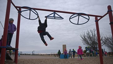 Gemachisa Deko, a kindergartener at Discovery Elementary School, plays on the playground during morning recess Wednesday, March 22, 2017, at Discovery Elementary School in Sioux Falls.