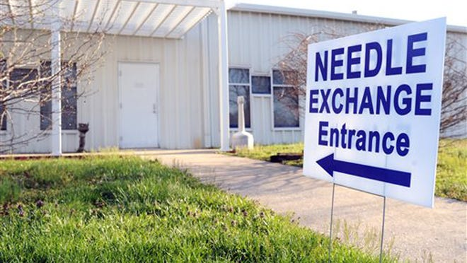 A sign points to the needle-exchange program at the Community Outreach Center in Austin, Ind. Even though HIV cases in Scott County have reached 150, state health officials hope the tide may be turning, since they have made contact with most of the people who are at risk of having contracted the virus from others who have already tested positive for it.