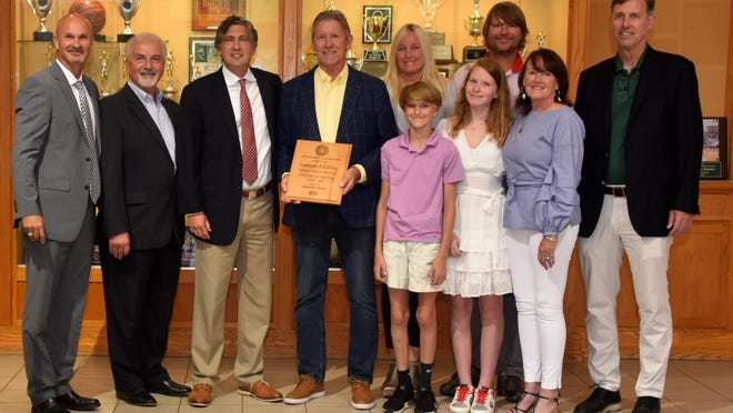 Savannah Country Day's Lamar Kirkley (holding plaque) was recently named the 2020 Teacher of the Year.