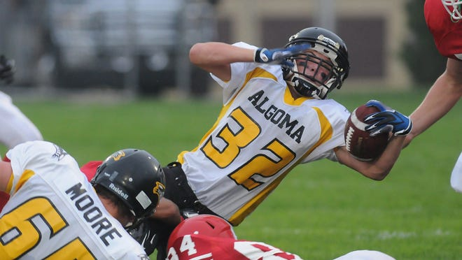 Algoma's Zach Schiesser reaches for extra yards against Sturgeon Bay on Aug. 22 at Sturgeon Bay.