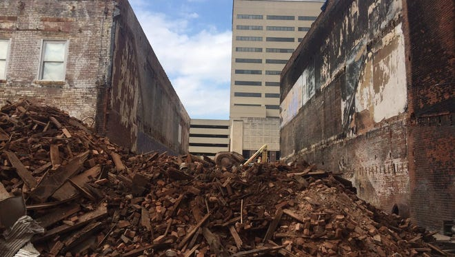 The remains of 219 and 217 Main St. in Downtown Evansville in October. The buildings were demolished after a fire damaged both buildings.