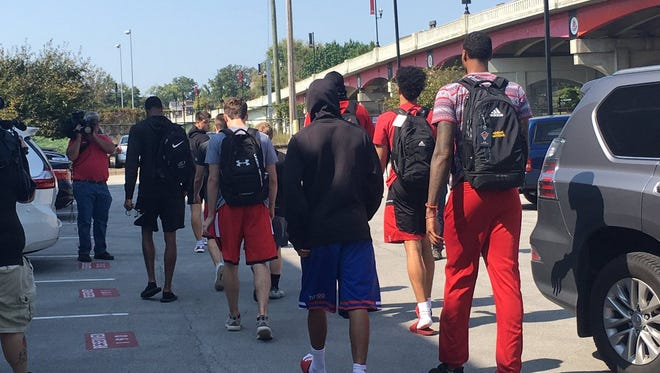 University of Louisville basketball players leave a team meeting Wednesday.