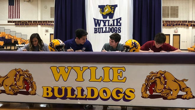 National Signing Day at Wylie High School on Wednesday, Feb. 7, 2018.