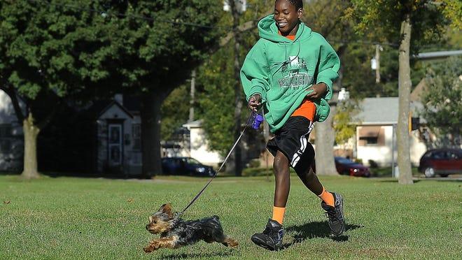 Antwane McNeal runs through Spellerberg Park with his dog, Suzzie, in 2014. The Spellerberg neighborhood is next up for Argus Leader Media's #SiouxFallsStories feature.