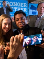 Chelsea Clinton poses for a photo while drumming up