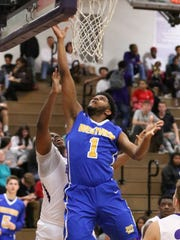 Westview's Ty Kelly goes up for a layup during the