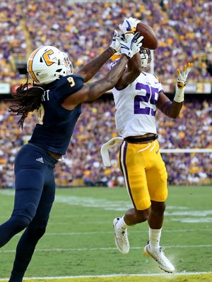 LSU cornerback Andraez Williams (29) deflects a pass intended for Chattanooga wide receiver Alphonso Stewart (9) during the first half of an NCAA college football game in Baton Rouge, La., Saturday, Sept. 9, 2017.