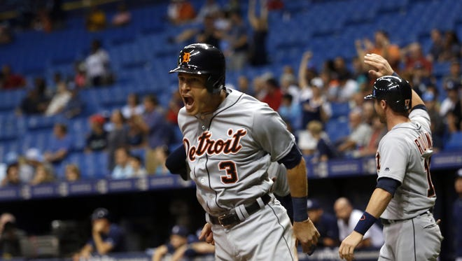 Ian Kinsler of the Detroit Tigers celebrates after scoring off of a three-run double by Cameron Maybin during the ninth inning. The Tigers scored eight runs to erase a five-run deficit in a 10-7 victory Thursday over the Rays.
