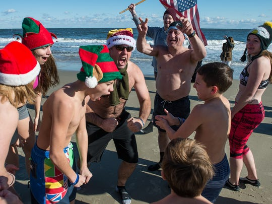 A team of swimmers prepare for the 24th Annual Penguin Swim near the Princess Royale Hotel in Ocean City on Monday, Jan. 1, 2018.