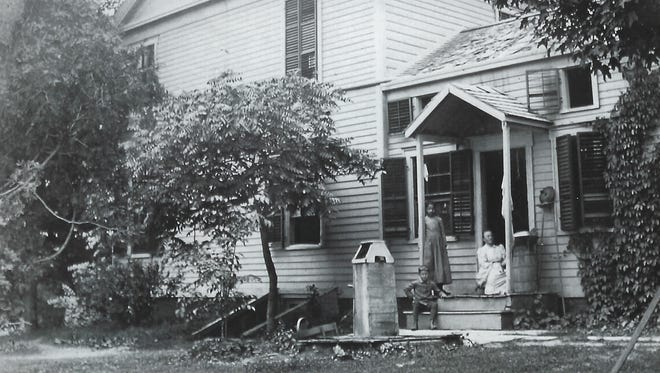 This circa 1870s photograph shows Gertrude Ferris Underhill sitting in the doorway of the large farmhouse, while her son Lindley is on the lower step. The girl standing in the center was the daughter of one of the servants.