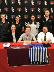 Stewarts Creek's Andrew Udulutch recently signed to play soccer at Cumberland University. Pictured in the front row (l-r) are Sara, Andrew, and Scott Udulutch. In the back row (l-r) are SCHS coaches Daniel Snyder, Brooke Mayo, Maggie Udulutch and TSC Coach Andy Stone.