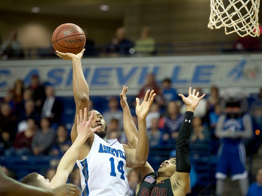 Ahmad Thomas shoots over the arms of defenders Dec. 31 during the Bulldog's Big South Conference opener against Gardner-Webb at the Kimmel Arena. The Bulldogs won in overtime, 90-85.