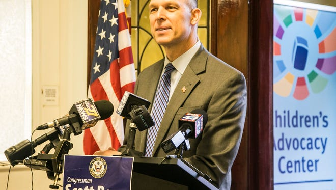 Rep. Scott Perry, R-York County, holds a news conference to unveil bipartisan legislation to ensure that money in the federal Crime Victims Fund is only used to assist crime victims, rather than paying for unrelated federal projects, Tuesday, Jan. 17, 2017, at the York County Children's Advocacy Center, in York City. Amanda J. Cain photo