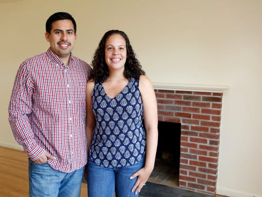 Levy and Jadera Garcia, who bought their first home with the help of Buyer's Edge Realty, Inc., are photographed April 30, 2015 in their home in White Plains.
