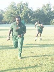 Dave Montas sprints to the finish line during summer workouts.