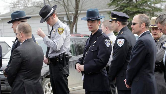 Well wishers pay respects April 3 at Chase Funeral Home, in Port Dickinson during calling hours for Johnson City Officer David Smith, who was killed in the line of duty.