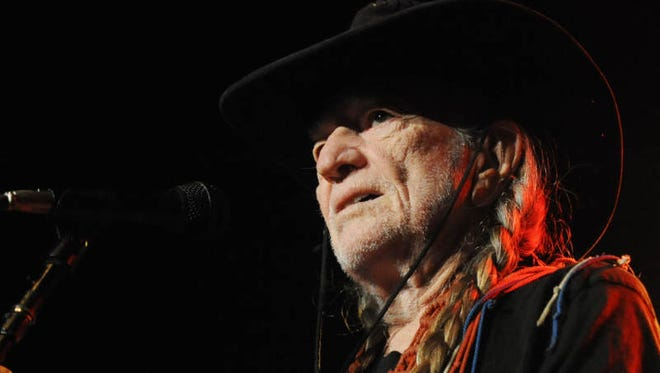 """Willie Nelson performs """"Beer for My Horses"""" at Brewsky's in Hattiesburg."""