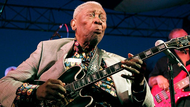 In this Aug. 22, 2012 photograph, ever the showman, 86-year-old B.B. King thrills a crowd of several hundred people  at the 32nd annual B.B. King Homecoming, a concert on the grounds of an old cotton gin where he worked as a teenager many years ago, in Indianola, Miss.