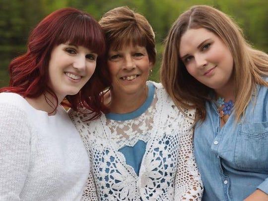 Donna Barker (center) was the mother of Melissa Barker (left) and MacKenzie Barker (right).
