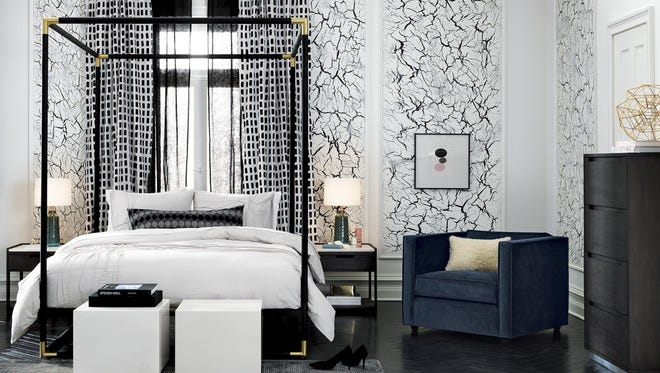 This bedroom from CB2 offers a good mix of details a couple might love, including a graphic rug and easy-to-love white bedding.