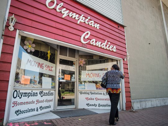Olympian Candies, 625 E. Main St., is seen in downtown Richmond on the afternoon of Monday, May 7, 2018.