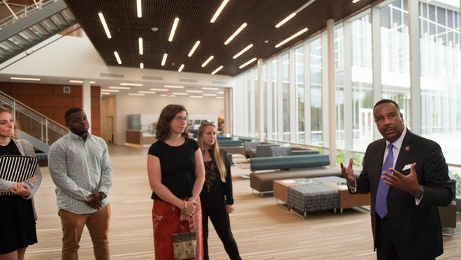 From left, Rowan students, Mara Dallas, Daniel Richards, Tane West,  (CQ) and Hunter Schaefer listen to Rowan President at Burlington County College Paul Drayton during a tour of the first-ever student center at Rowan College at Burlington County. The four students had  a great deal of input in the interior designed areas of the center.